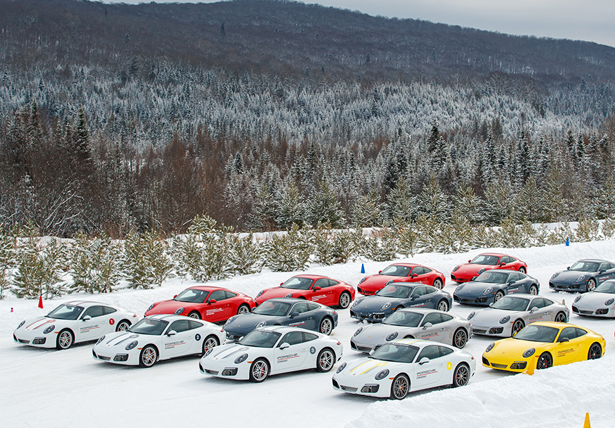 Porsche cars line up on the snowy track