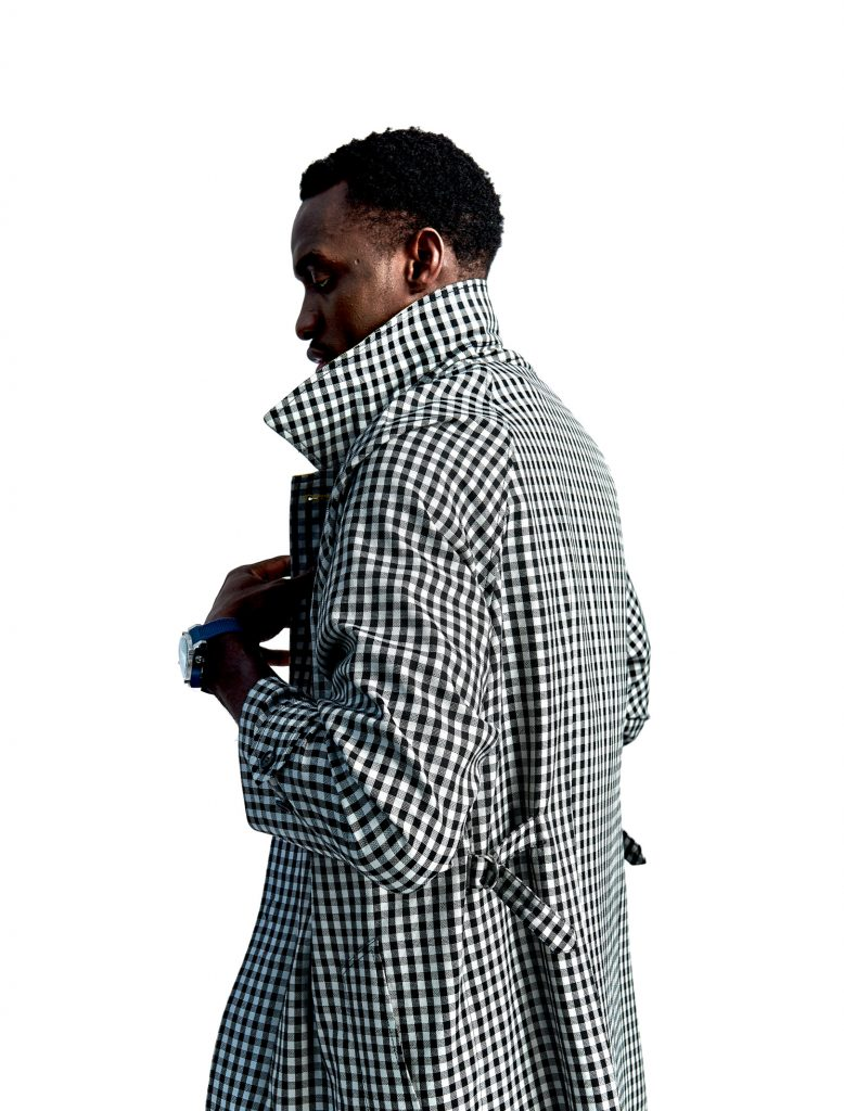 Pascal Siakam wears a checkered trench coat