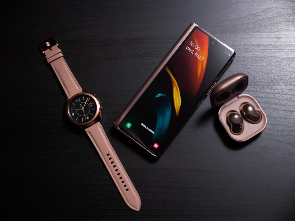 Samsung Galaxy Zfold2 phone, watch and earbuds on table