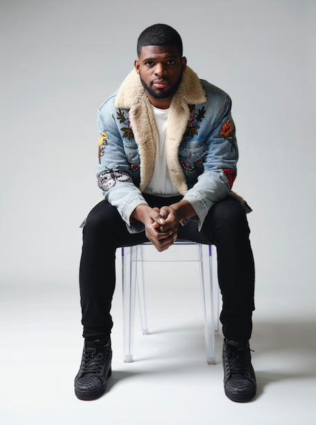 P.K. Subban in white shirt and denim jacket sitting on chair