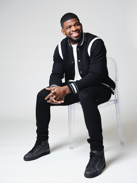 P.K. Subban wearing black jeans and jacket on chair