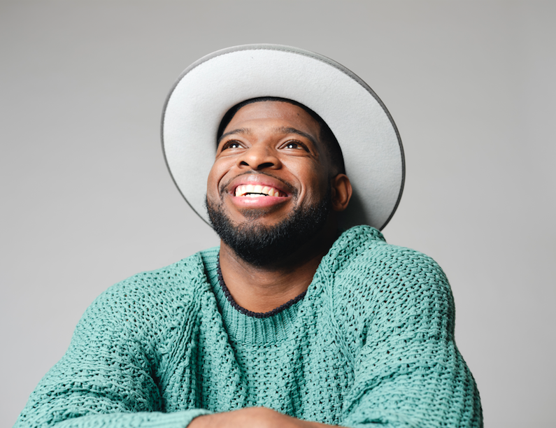 P.K. Subban wearing green sweater and hat