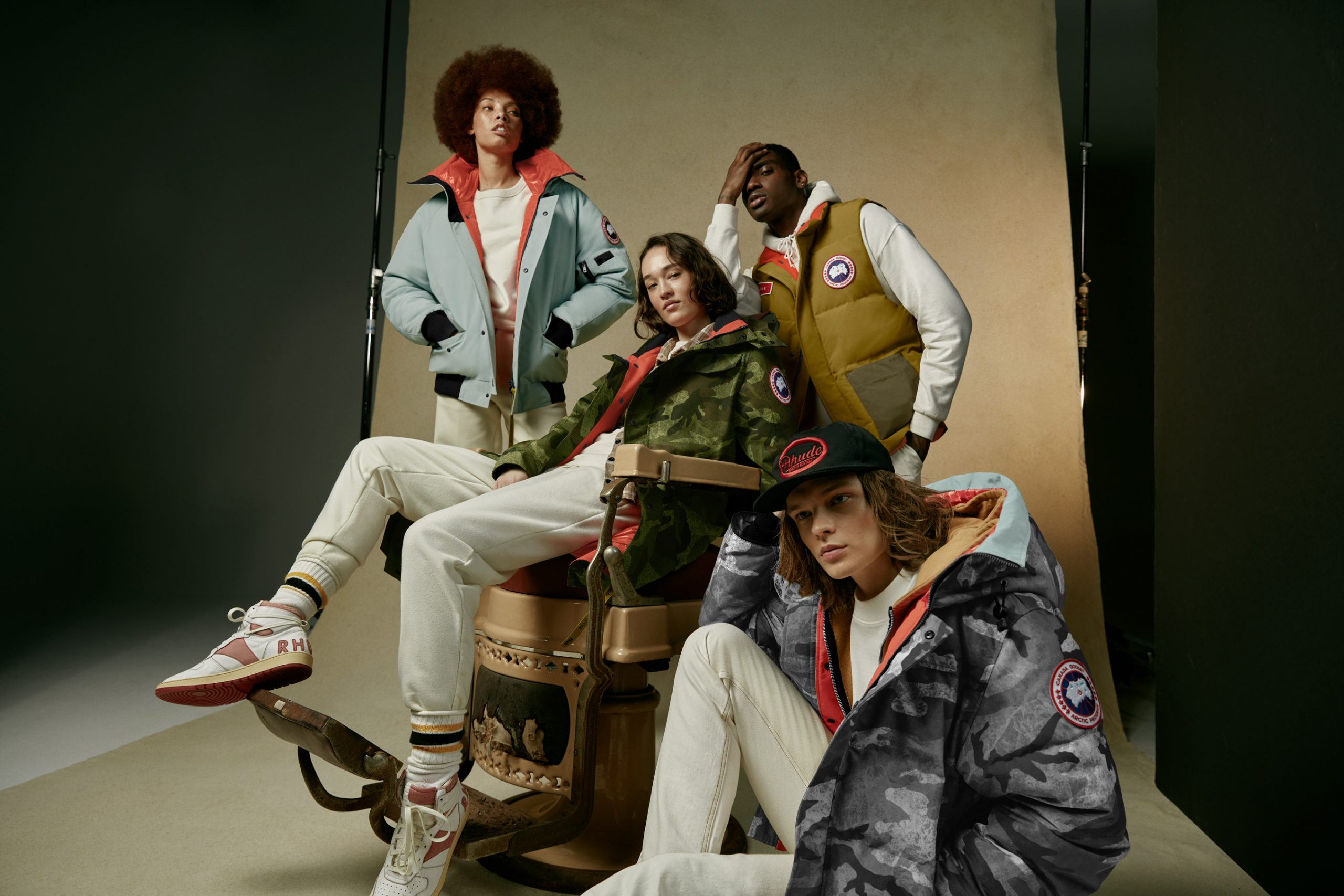 NBA X Canada Goose promo image: four models wearing Canada Goose gear together on a set.