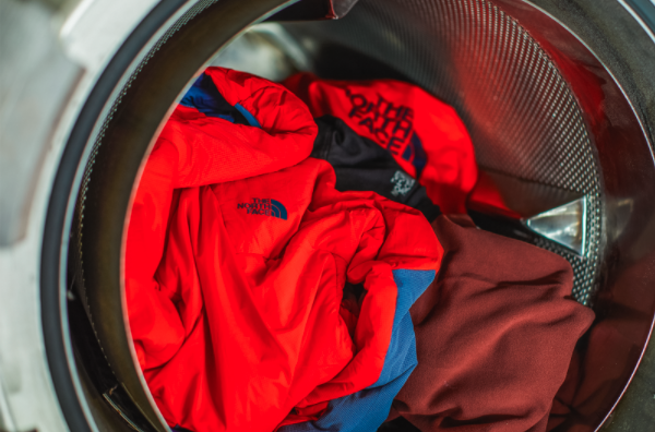 The North Face red jacket in washing machine