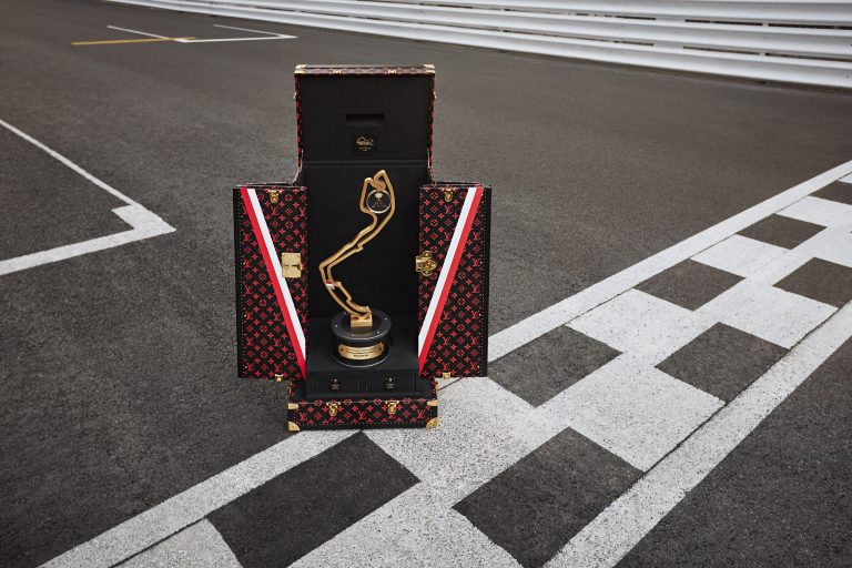 The trophy case by Louis Vuitton and Formula 1 sits on a race track.