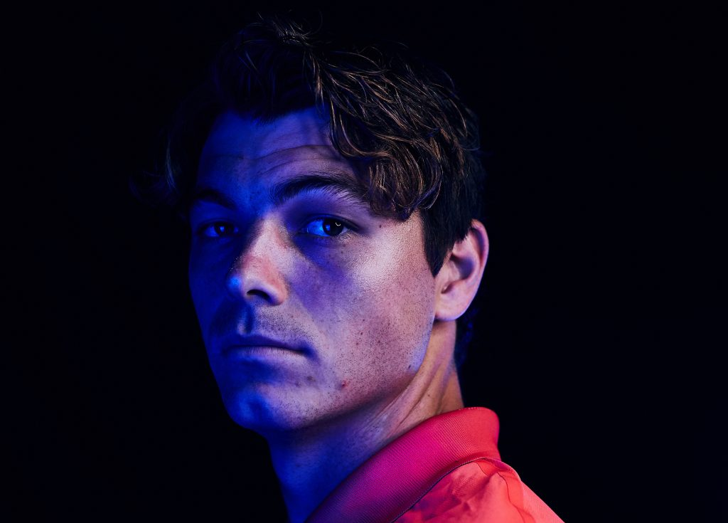 Taylor Fritz in red polo looking in camera