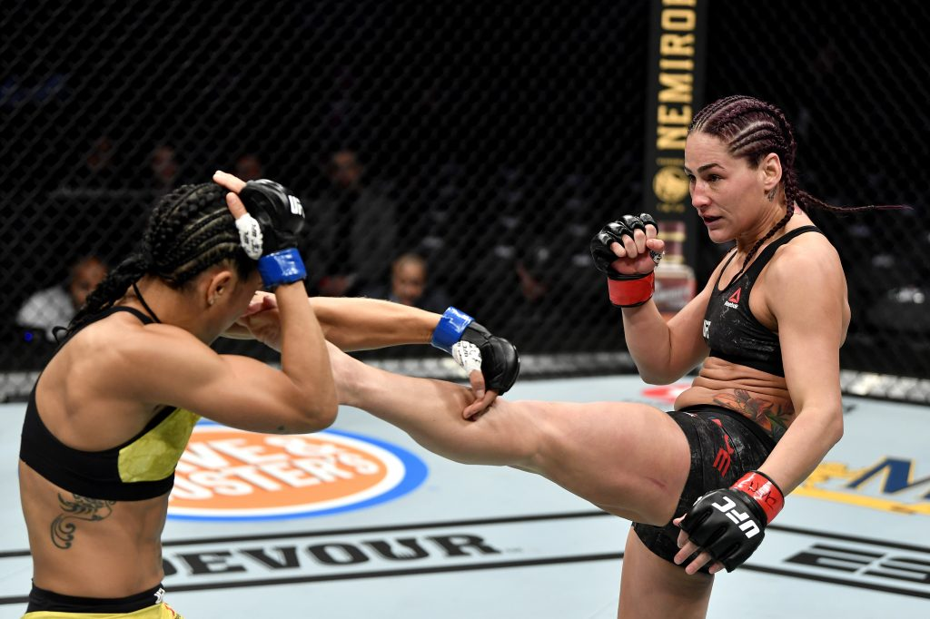 Jessica Eye kicks Viviane Araujo of Brazil in their women's flyweight bout during the UFC 245 event at T-Mobile Arena on December 14, 2019 in Las Vegas, Nevada.