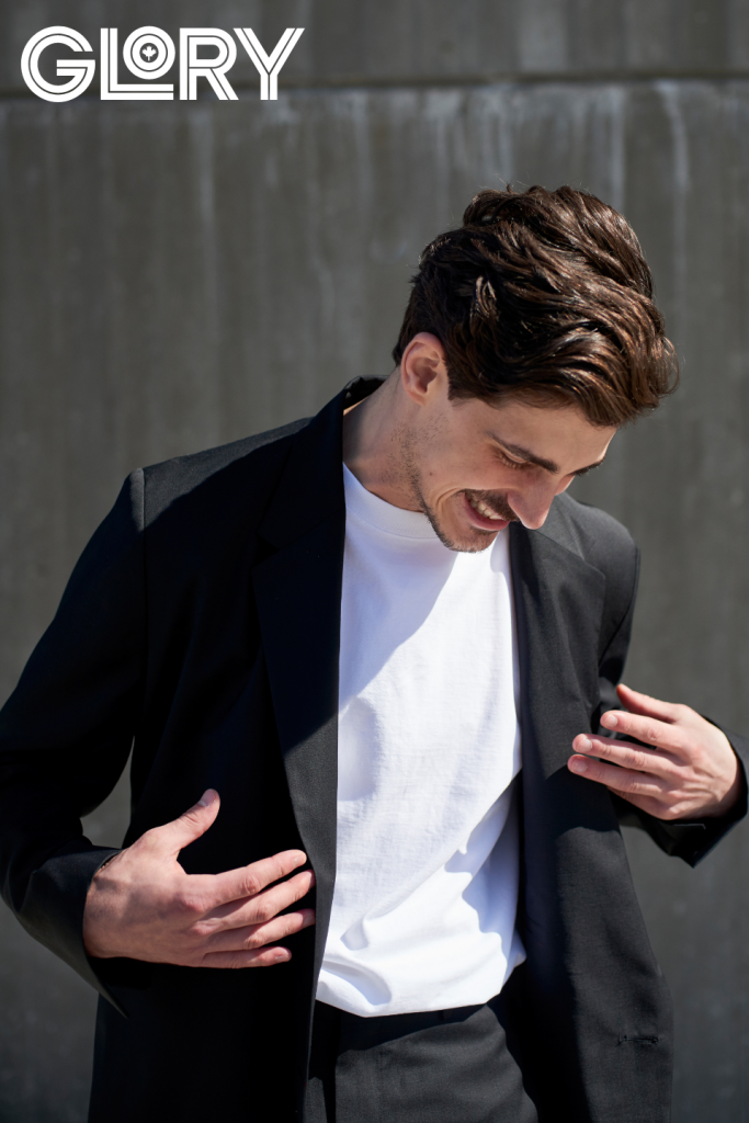 Paul Poirier in black jacket with white tee laughing