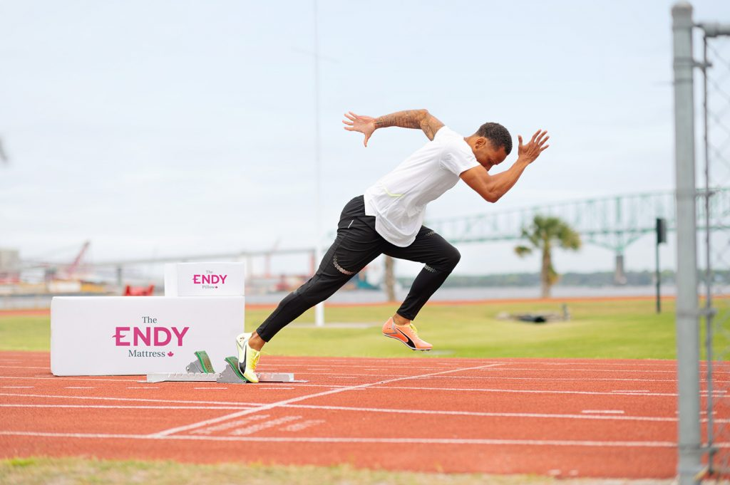 Andre De Grasse running on a track for ENDY